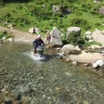 Jaspinder crossing water on a road to bhaderwah from sarthal